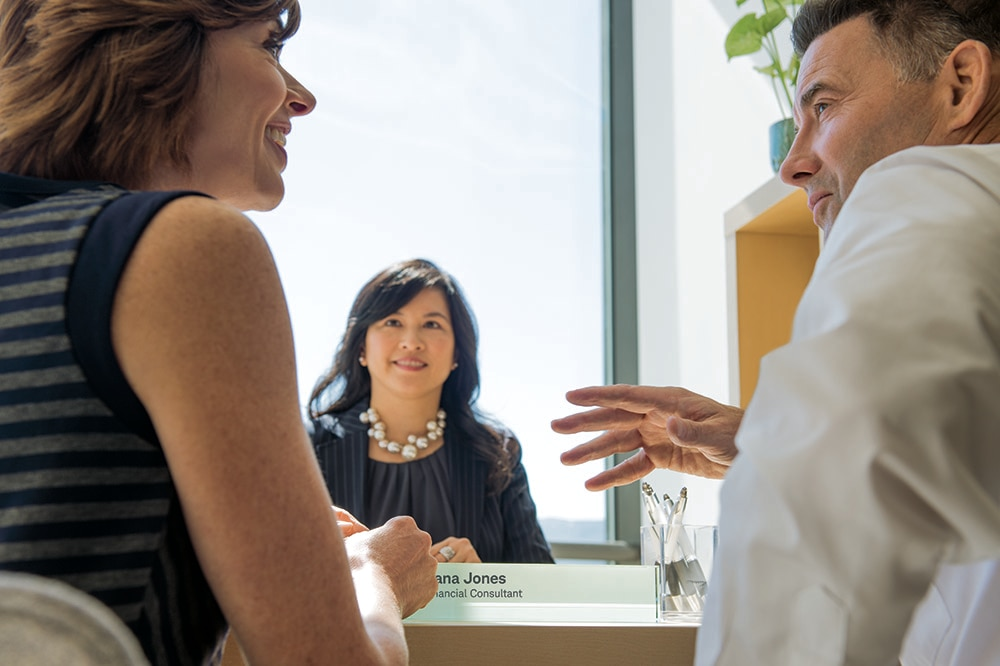 Couple speaking with a consultant